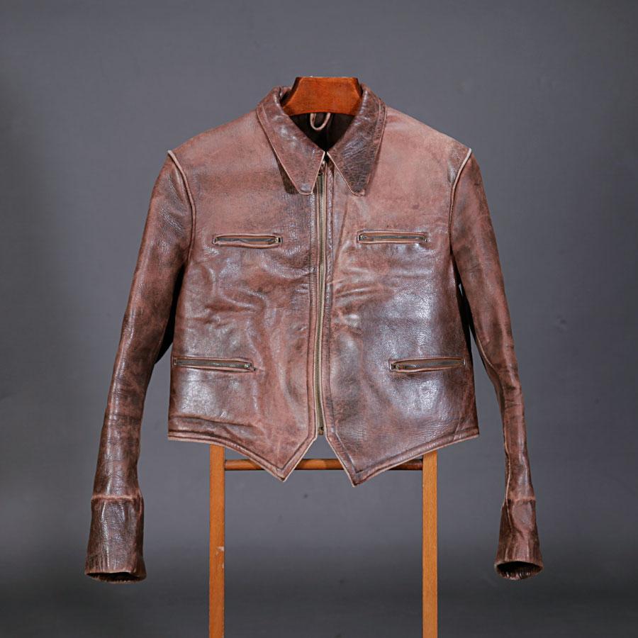 Late 40's motorcyclist leathet jacket